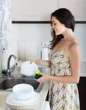 Housewife washing dishes Stock Photo