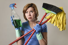 Housewife in washing gloves with cleaning spray bottle broom and Royalty Free Stock Photos