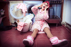 Housewife with washing machine and towels. Royalty Free Stock Photos