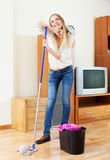 Housewife washing parquet floor with mop  at home Stock Photos