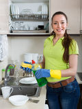 Housewife washing plates in kitchen Stock Image