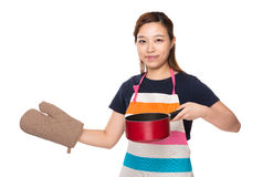Housewife wear with oven gloves and hold with saucepan Stock Images