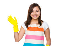 Housewife wear a pair of rubber gloves Royalty Free Stock Photos