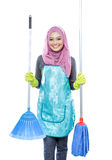 Housewife wearing hijab holding broom and mop Stock Image