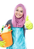 Housewife wearing hijab holding bucket full of cleaning supplies Royalty Free Stock Photo