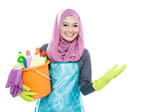 Housewife wearing hijab holding bucket full of cleaning supplies Royalty Free Stock Images