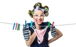 Housewife with wet clothes over white Stock Images