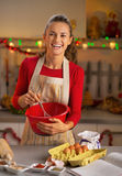 Housewife whisking dough in christmas kitchen Royalty Free Stock Image