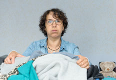 Housewife who don't want to do ironing. A housewife who don't want to do ironing royalty free stock photo