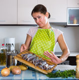 Housewife wincing of fish smell Royalty Free Stock Images
