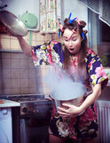 Housewife With A Pan In Hands Royalty Free Stock Image