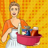 A housewife. Woman with a basin with bottles of different household chemicals