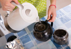 Housewife woman  brewing tea at home Royalty Free Stock Photos