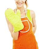Housewife woman with oven mittens and orange apron Royalty Free Stock Photo