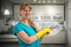 Housewife woman washing dishes in kitchen royalty free stock image