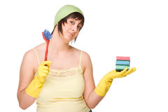 Housewife at work. Full isolated portrait of a beautiful caucasian woman with some cleaning equipment royalty free stock photo