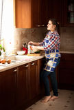 Housewife working on classic wooden kitchen with big window Royalty Free Stock Image
