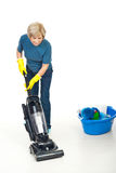 Housewife working with vacuum cleaner stock photos