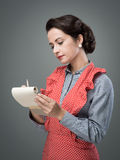 Housewife writing down recipe ingredients Royalty Free Stock Photography