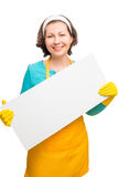Housewife in yellow apron holding a white poster Stock Images