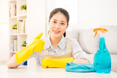 Housewife in yellow gloves showing thumbs up Royalty Free Stock Images