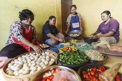 HOUSEWIVES COOKING TOGETHER. Housewives are preparing spices and seasonings for their family meal at Gresik, Java, Indonesia. Due their vast cultural diversity Royalty Free Stock Photos