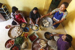 HOUSEWIVES COOKING TOGETHER. Housewives are preparing spices and seasonings for their family meal at Gresik, Java, Indonesia. Due their vast cultural diversity Royalty Free Stock Photography