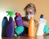 Housework. Woman and housework. Focus on chemical stock images