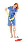 Housework. Portrait of nice housewife in blue robe doing housework with brush stock images
