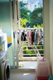 Housework. Hanging clothes on condo balcony Stock Photo