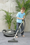 Housework. 6-7 years old boy cleaning carper - housework stock images