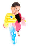Housework. Attractive brunette woman doing housework royalty free stock image