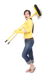 Housework. Attractive brunette woman doing housework Royalty Free Stock Images