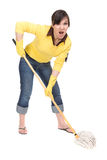 Housework. Attractive brunette woman doing housework stock images