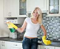 Housework. Chores around the house. Young  housewife cleans the kitchen Stock Photography