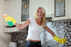 Housework. Chores around the house. Young  housewife cleans the kitchen Royalty Free Stock Photos