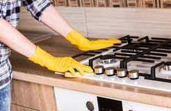 Housework - cleaning the kitchen. Royalty Free Stock Image