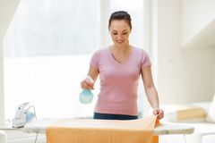 Woman or housewife ironing towel at home Royalty Free Stock Photos