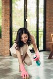 Housework and housekeeping concept. Woman cleaning floor with mo royalty free stock image