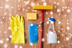 Squeegee with window cleaning stuff on wood Stock Images
