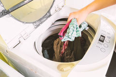 Housework. Housewife picks cloth out of washing machine,housework Stock Photos