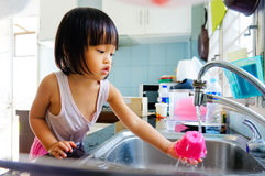 Housework. A little girl do housework royalty free stock photo