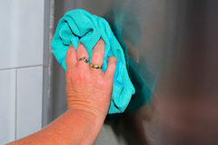 Housework wipe off dust and dirt with blue rags. Royalty Free Stock Photos