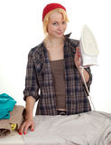 Housework - woman ironing clothes Stock Images