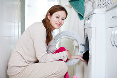 Housework young woman doing laundry Stock Images