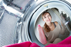 Housework young woman doing laundry. Housework: young woman doing laundry (shallow DOF; color toned image Royalty Free Stock Photo