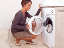 Housework of young woman. Housework, young woman doing laundry Royalty Free Stock Image