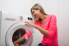 Free Housework: Young Woman Doing Laundry Royalty Free Stock Photos - 56416488