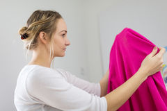 Housework: young woman doing laundry Royalty Free Stock Photos
