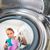 Housework: young woman doing laundry. (shallow DOF; color toned image Royalty Free Stock Photography